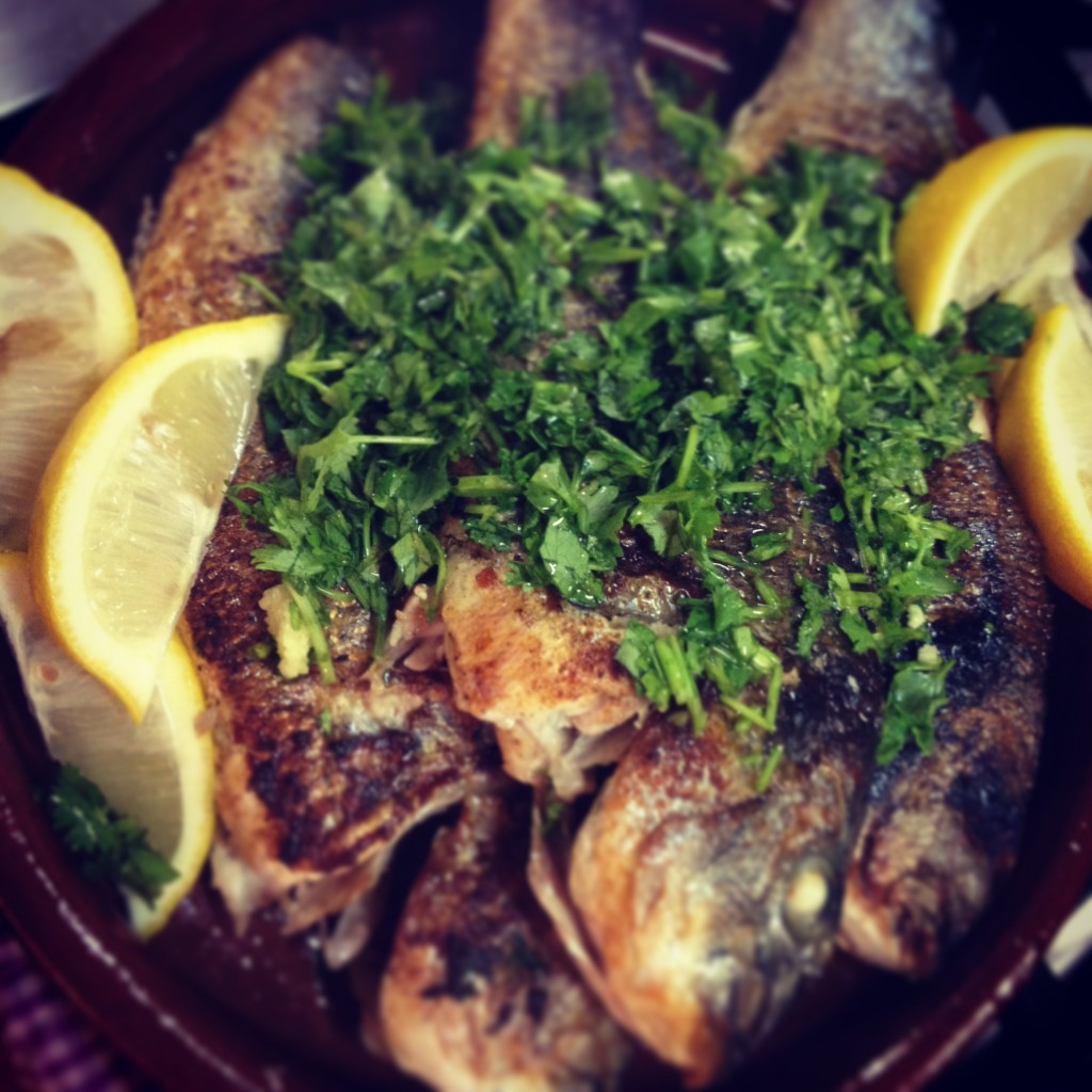 Whole sea bream with parsley & sundried tomatoes