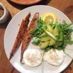 Peppered mackerel with an avocado and rocket tower and poached eggs